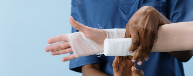doing bandage on a hand
