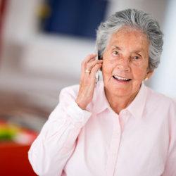 elderly holding a phone