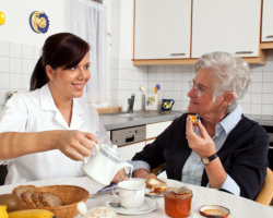 caregiver assisting patient in eating