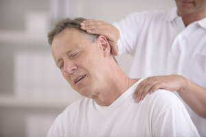 caregiver massaging patient