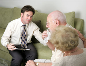 man talking to sad clients